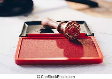 Metal notary public ink stamper. Law office.