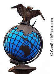 metal owl with world globe isolated on white background