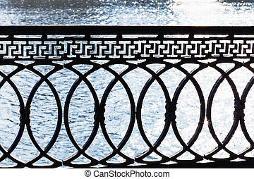 metal parapet on waterfront in sunny spring day