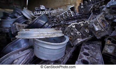 metal parts of old broken automobiles are lying in heaps of...