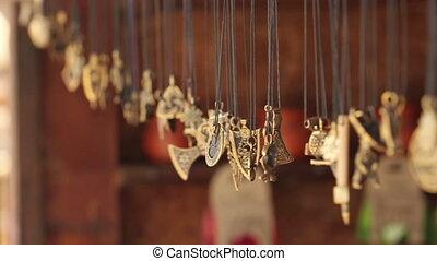 metal pendants swaying in the wind