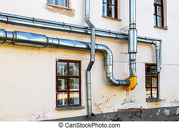 Metal pipes mounted on the wall