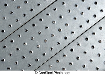 Metal plate floor close up.