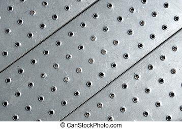 Metal plate floor close up.