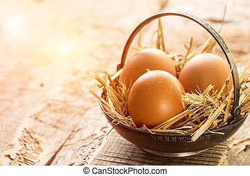 Metal plate full of easter eggs on rustic wooden table