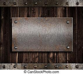 metal plate on old wooden wall or door