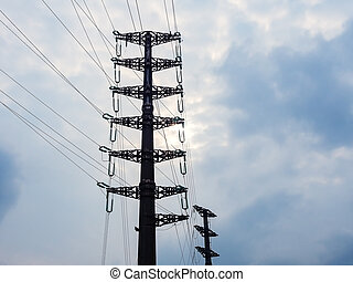 Metal pole with many electrical wires against a cloudy sky background. Power station