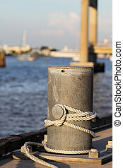 Metal post on the dock - A metal post along the dock on the...