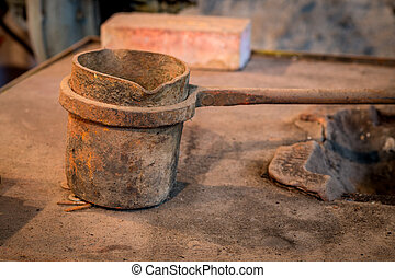 Metal pot use for melting other metals in a workshop