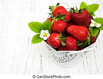 Metal pot with strawberries