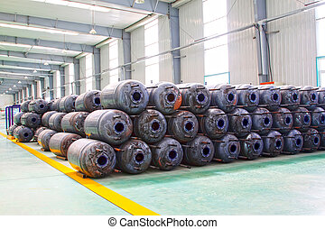 Metal pressure tank piled up together, closeup of photo