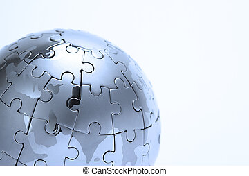 Metal puzzle globe isolated on white background, close-up in...