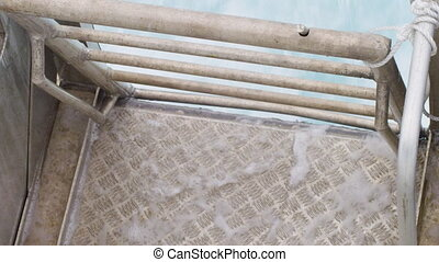 Metal rail with water's coming in - A birds eye view of a...