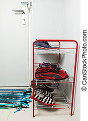 Metal red shelf with shoes