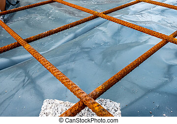 Metal reinforcement grid and wood frame for reinforced concrete basement construction