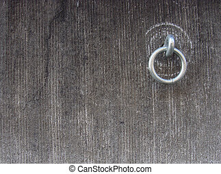 metal ring attached to a stone grunge wall