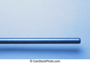 Metal rod over white background