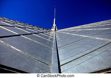 Metal Roof - Metal roof leading to a steeple.