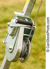 Metal rope hooked on the reel