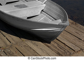 Metal row boat - Metal old-fashioned row-boat sitting on the...