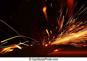 metal sawing close up sparks spray
