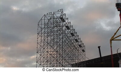 Metal scaffolding and building towers at construction site....