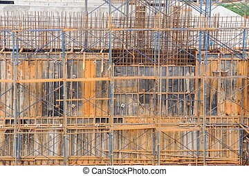 Metal scaffolding by work on dam construction site, Thailand.