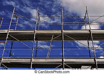 metal scaffolding in building and blue sky background