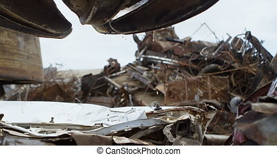 Metal scrap in the junkyard 4k - Various metal scrap in the...