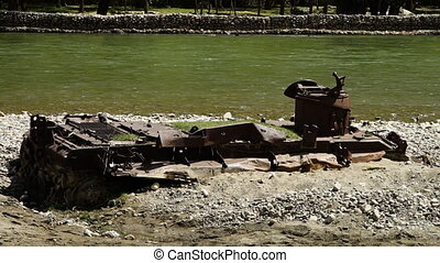 Metal scraps situated near the river - A steady, medium shot...