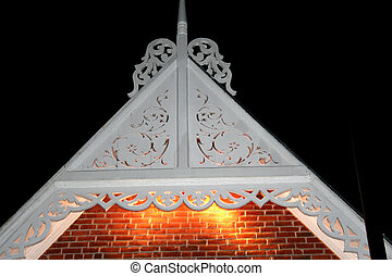 Metal scroll work - Metal scroll-work on a rooftop with...
