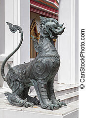 metal security dog in buddhistic temple of Thailand, Bangkok.