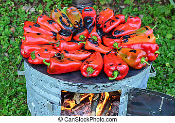 Metal sheet cooker full of roasted peppers