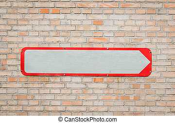 Metal sign with an arrow