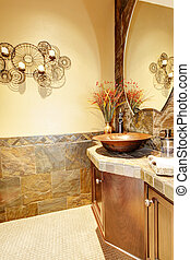 Metal Sink with wood cabinet and stone tiles. - Sink with...