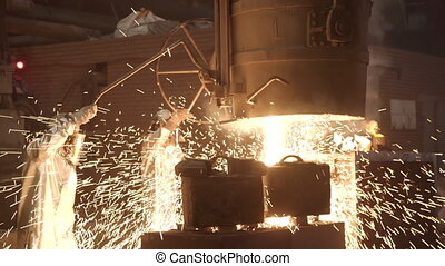 Metal smelting furnace in steel mill. Molten metal pouring, metallurgy, steel casting foundry. Furnace in which metal is melted. Metallurgical industry