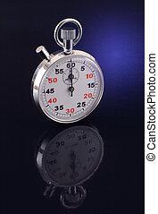 chronometer - metal sport chronometer on the black ...