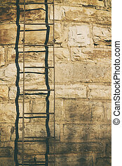 Metal stair on stone wall