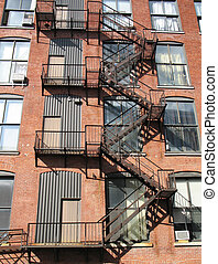 metal stairs on a brick building