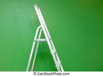 metal stepladder on a green background