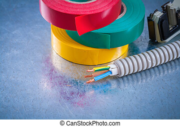 Metal strippers conduct tubing wires and insulating tape.