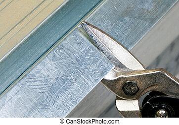 Metal stud cutting - Cutting steel stud with tin snip cutter