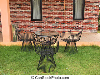 metal table and chairs on a grass