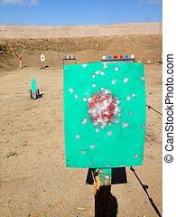 Metal targets at shooting range outdoor firearm rifle shotgun practice