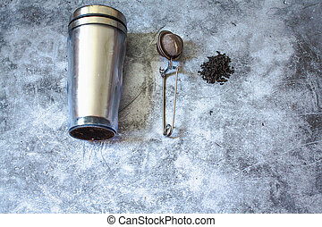 Metal thermos and tea infuser. Eco friendly Zero waste plastic free kitchen on gray background. concept sustainable lifestyle or Recycling and ecology.