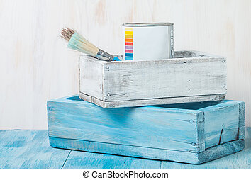 Metal tin can with paint and brush