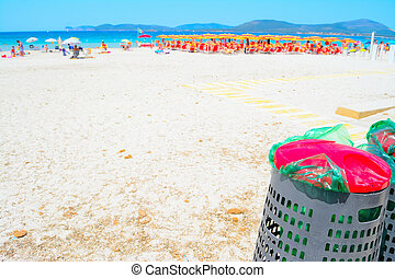 metal trash cans on the sand
