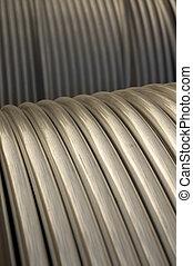 Metal Tubing - Silver metal tubing or conduit abstract on...