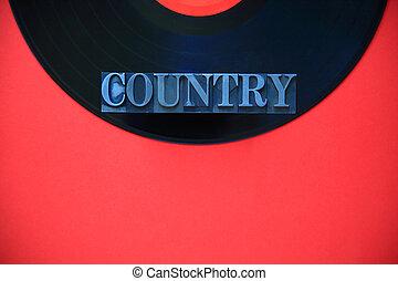 Metal type word country on vinyl
