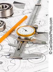 Metal vernier caliper on technical drawing